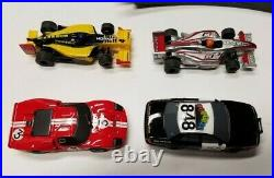 4 AFX 164 cars with track pieces GT40 Mega G, Highway Patrol, 2 of F1