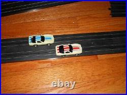 Tyco Zero Gravity Cliff Hanger Slot Car Set & Nite Glow Corvettes withExtra Tracks